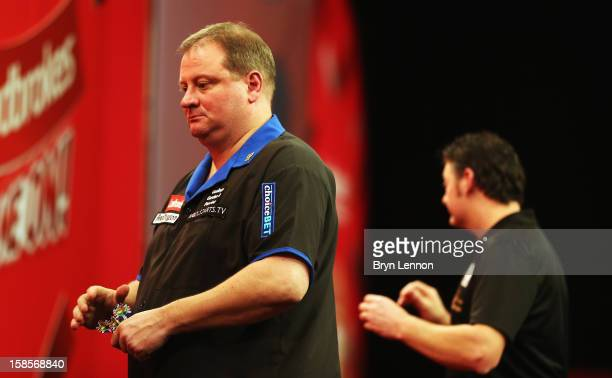 Andy Jenkins of England reacts during day 6 of the 2013 Ladbrokescom World Darts Championship at Alexandra Palace on December 19 2012 in London...