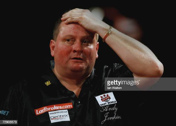 Andy Jenkins of England reacts during his match against Raymond Van Barneveld of Holland during the semifinals of the Ladbrokes World Darts...