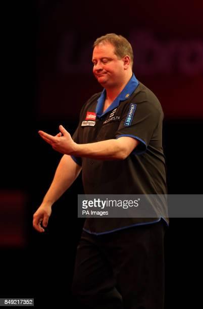 Andy Jenkins reacts on his way to defeat during the Ladbrokescom World Darts Championship at Alexandra Palace London