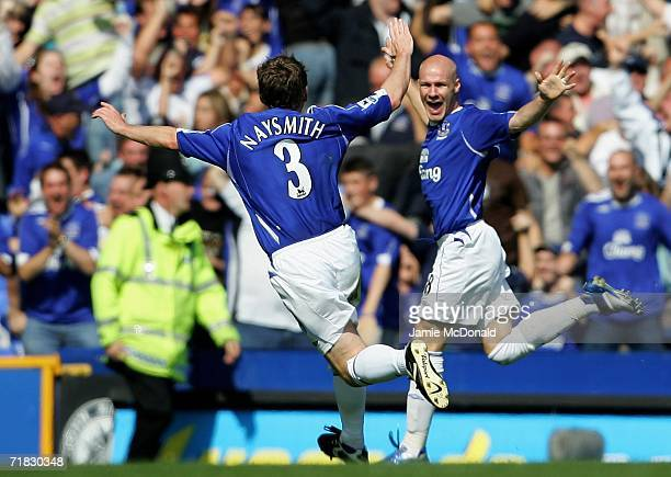 Andy Johnson of Everton is congratulated by team mate Gary Naysmith after scoring his team's second goal during the Barclays Premiership match...