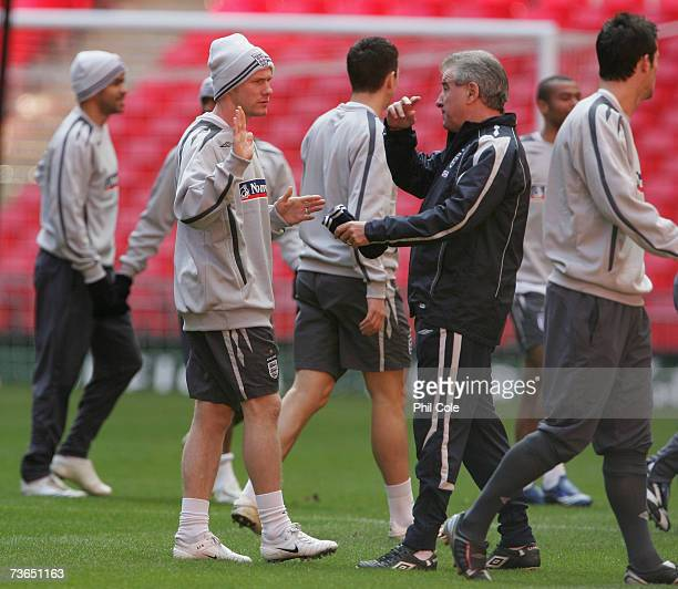 Andy Johnson speaks with Assistant coach Terry Venables during the England training session at Wembley Stadium on March 21 2007 in London England