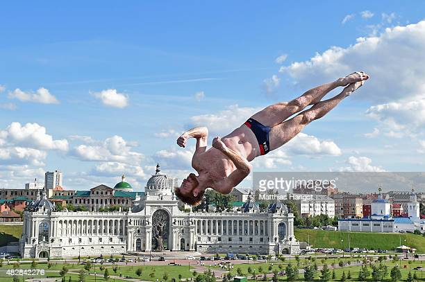 Andy Jones of the United States competes in the Men's High Diving 27m preliminary round on day ten of the 16th FINA World Championships at the...