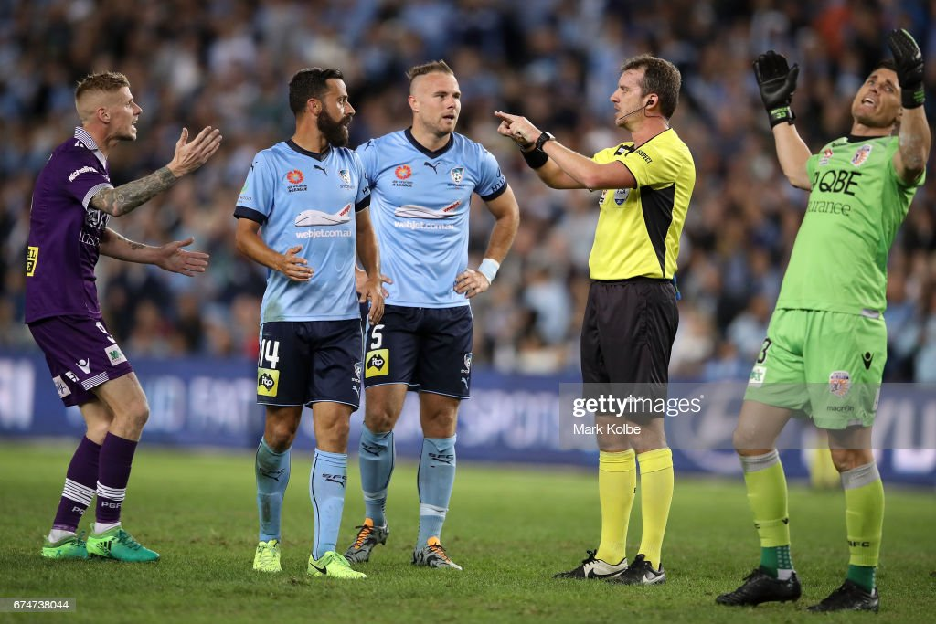 Andy Keogh (L) and Liam Reddy (33) of the Glory react and Alex Brosque and Jordy Buijs of Sydney FC watch on as referee Peter Green calls for a video referral for a goal decision during the A-League Semi Final match between Sydney FC and the Perth Glory at Allianz Stadium on April 29, 2017 in Sydney, Australia.