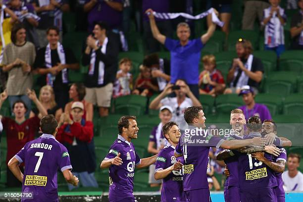 Andy Keogh Josh Risdon and Diego Castro of the Glory celebrate a goal during the round 23 ALeague match between the Perth Glory and the Central Coast...