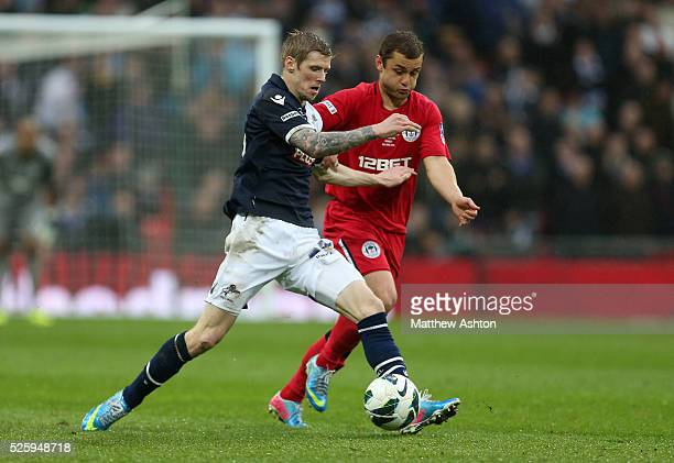 Andy Keogh of Millwall and Shaun Maloney of Wigan Athletic