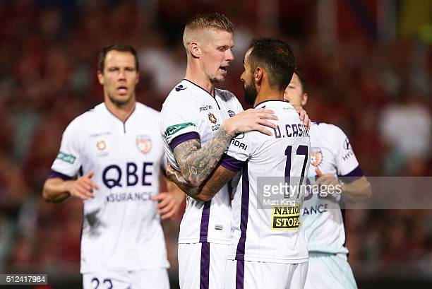 Andy Keogh of Perth Glory celebrates with Diego Castro after scoring a goal during the round 21 ALeague match between the Western Sydney Wanderers...