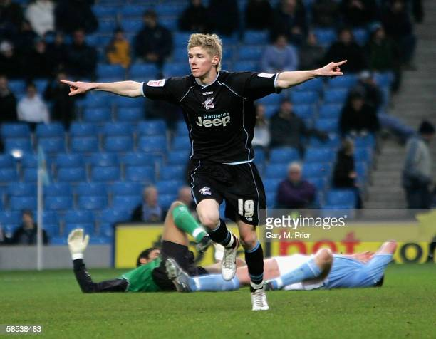 Andy Keogh of Scunthorpe United celebrates scoring during the FA Cup third round match between Manchester City and Scunthorpe United at The City of...
