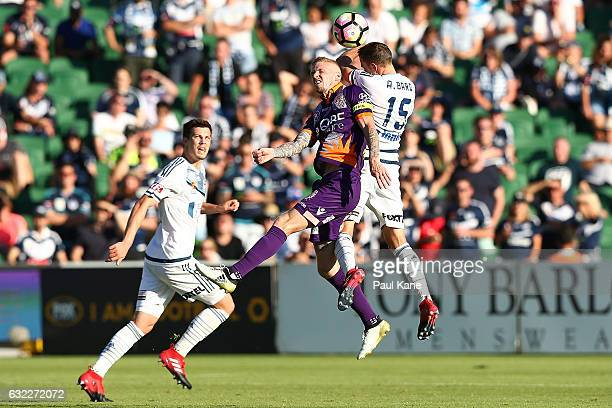 Andy Keogh of the Glory and Alan Baro of the Victory contest for a header during the round 16 ALeague match between Perth Glory and Melbourne Victory...