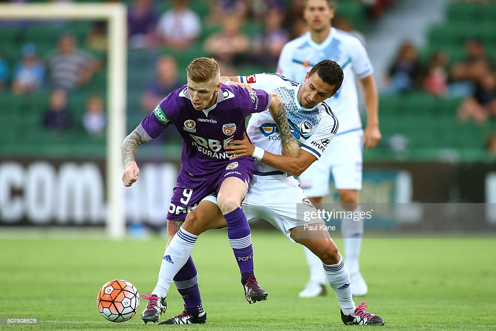 Andy Keogh of the Glory and Daniel Georgievski of the Victory contest for the ball during the round 17 A-League match between Perth Glory and Melbourne Victory at nib Stadium on January 30, 2016 in Perth, Australia.