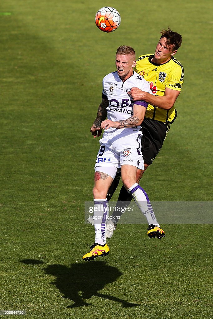 Andy Keogh of the Glory and Dylan Fox of the Phoenix compete for a header during the round 18 A-League match between Wellington Phoenix and Perth Glory at Westpac Stadium on February 7, 2016 in Wellington, New Zealand.