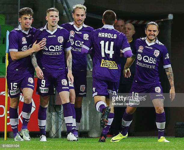 Andy Keogh of the Glory celebrates a goal during the round three ALeague match between Melbourne City FC and Perth Glory at AAMI Park on October 21...