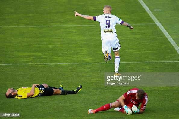 Andy Keogh of the Glory celebrates his goal while Andrew Durante and Glen Moss of the Phoenix show their dejection during the round 24 ALeague match...