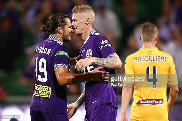Andy Keogh of the Glory celebrates with Josh Risdon after scoring a goal from a penalty kick during the round 23 ALeague match between the Perth...