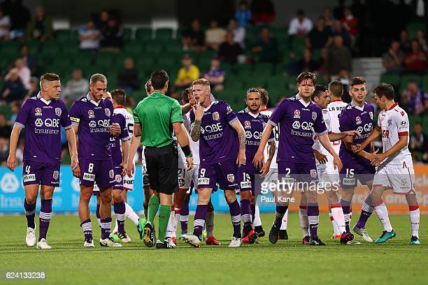 Andy Keogh of the Glory gestures to Referee Jarred Gillett after being taken down in a tackle during the round seven ALeague match between the Perth...