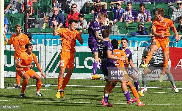 Andy Keogh of the Glory heads home the winning goal during the round two ALeague match between the Perth Glory and Brisbane Roar at nib Stadium on...
