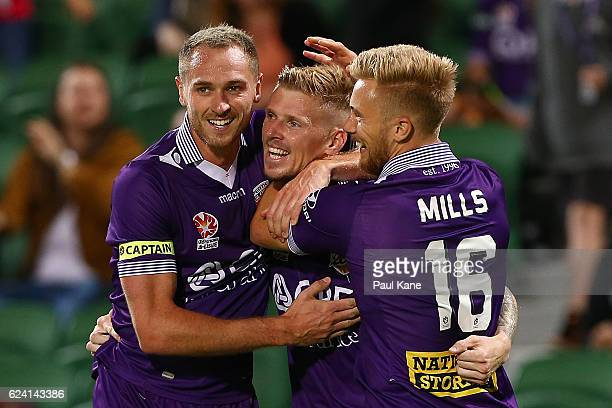 Andy Keogh of the Glory is congratulated by Rostyn Griffiths and Joseph Mills after scoring a goal during the round seven ALeague match between the...