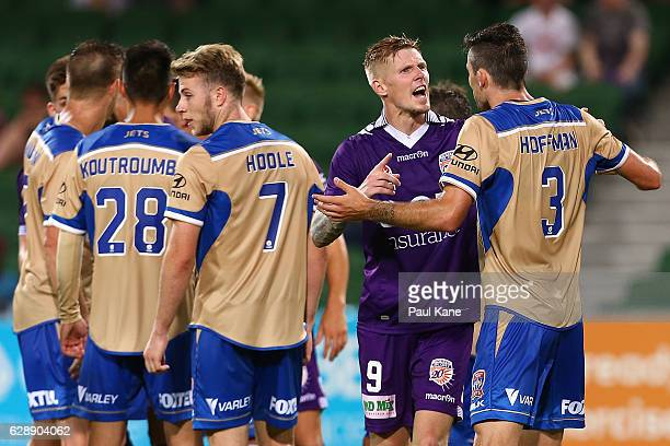 Andy Keogh of the Glory talks with Jason Hoffman of the Jets after a melee during the round 10 ALeague match between the Perth Glory and the...