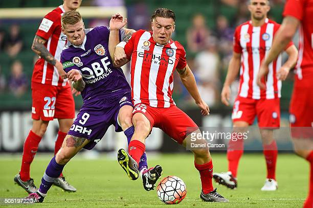 Andy Keogh of the Perth Glory clashes with Jacob Melling of the Melbourne City FC during the round 15 ALeague match between Perth Glory and Melbourne...