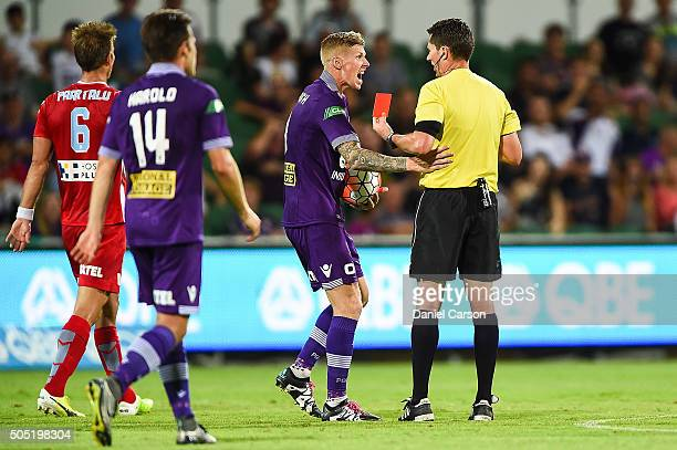 Andy Keogh of the Perth Glory contests the red car given to Jacob Collard of the Perth Glory during the round 15 ALeague match between Perth Glory...