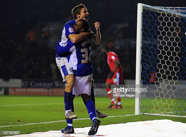 Andy King of Leicester celebrates with team mate Darius Vassell after scoring the first goal during the npower Championship match between Leicester...