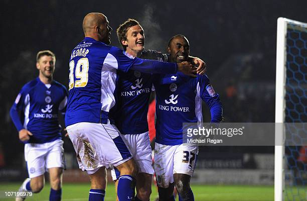 Andy King of Leicester celebrates with team mates Darius Vassell and Roman Bendnerafter scoring the first goal during the npower Championship match...