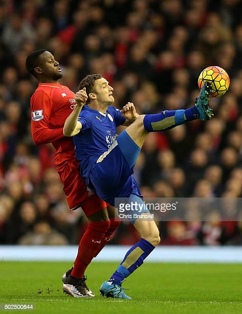 Andy King of Leicester City battles for the ball with Divock Origi of Liverpool during the Barclays Premier League match between Liverpool and...