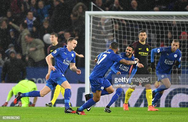 Andy King of Leicester City celebrates scoring his sides second goal with his Leicester City team mates during the Premier League match between...
