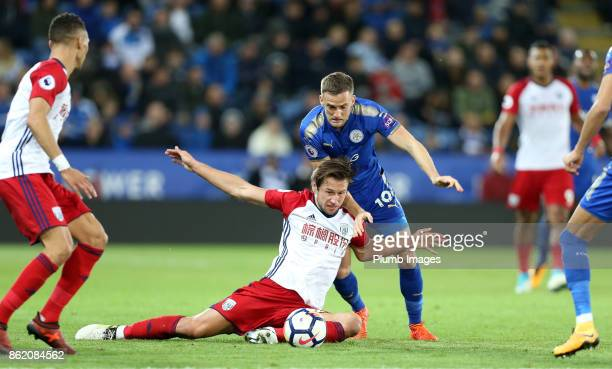 Andy King of Leicester City in action with Grzegorz Krychowiak of West Bromwich Albion during the Premier League match between Leicester City and...