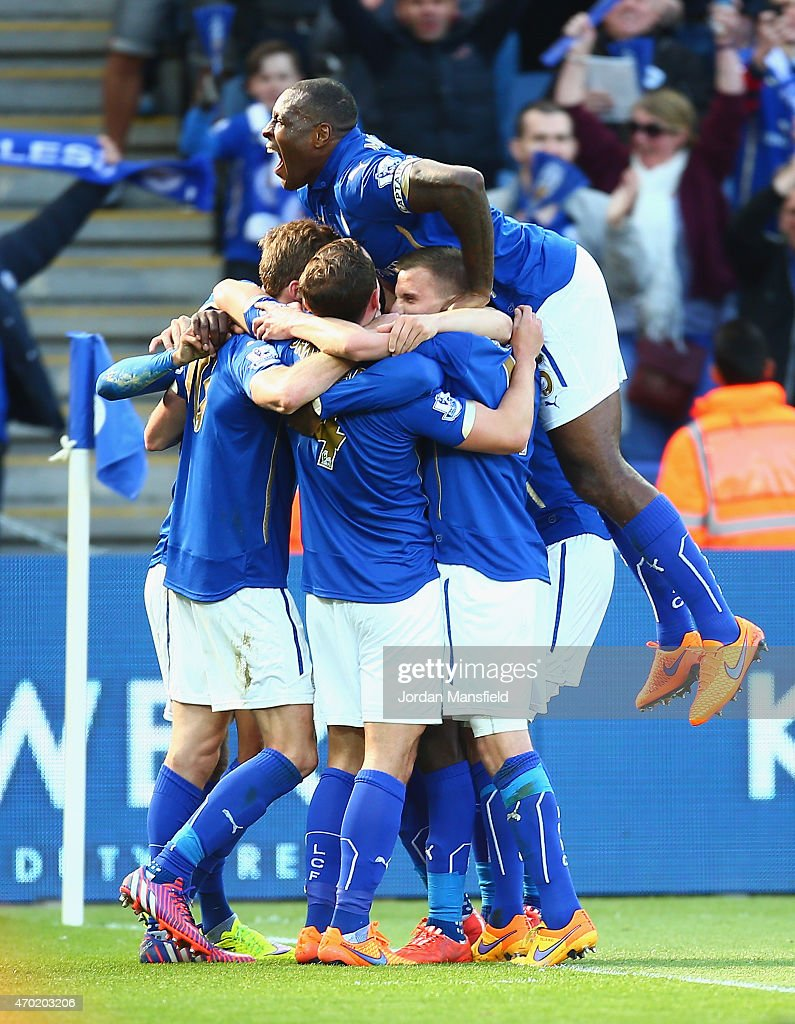 Andy King of Leicester City is mobbed by his team mates after he scored the second goal during the Barclays Premier League match between Leicester City and Swansea City at The King Power Stadium on April 18, 2015 in Leicester, England.