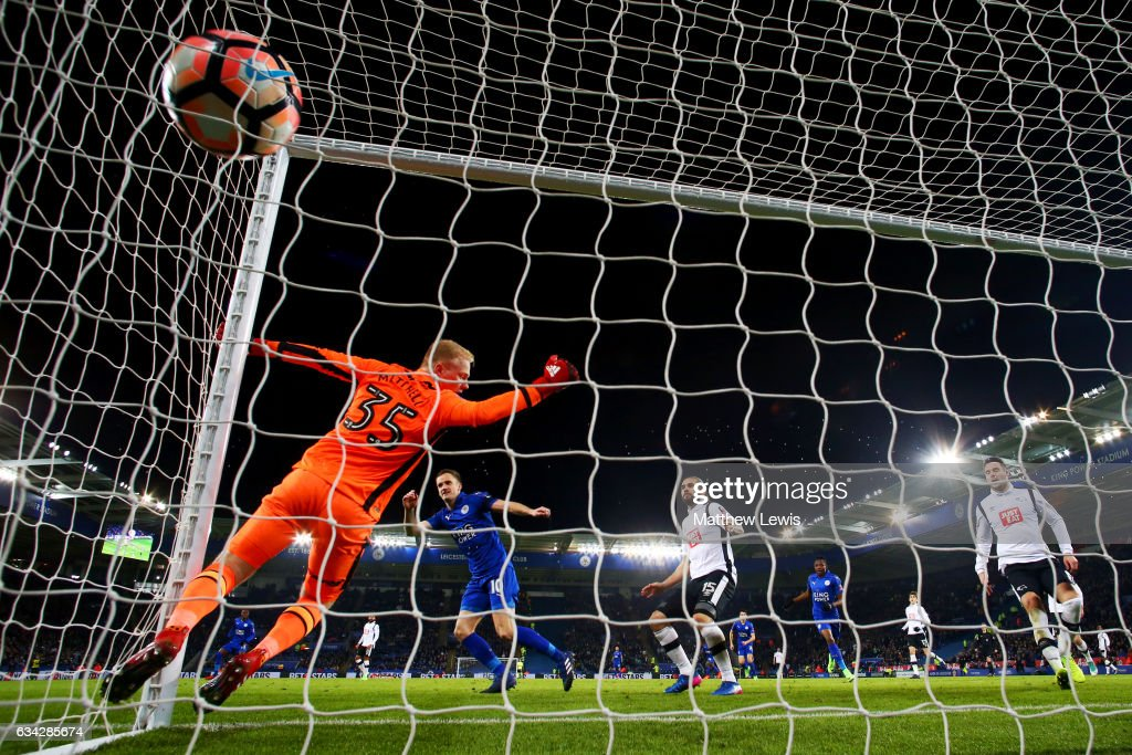 Andy King of Leicester City scores the opening goal past Jonathan Mitchell of Derby County during the Emirates FA Cup Fourth Round replay match between Leicester City and Derby City at The King Power Stadium on February 8, 2017 in Leicester, England.