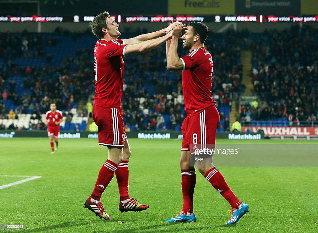 Andy King (L) of Wales celebrates scoring the opening goal with Hal Robson Kanu (R) during the international friendly football match between Wales and Finland at Cardiff City Stadium in Cardiff, south Wales on November 16, 2013.