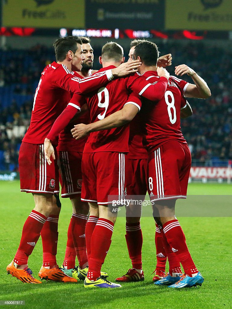 Andy King of Wales celebrates scoring the opening goal with Hal Robson Kanu (R) during the international friendly football match between Wales and Finland at Cardiff City Stadium in Cardiff, south Wales on November 16, 2013.
