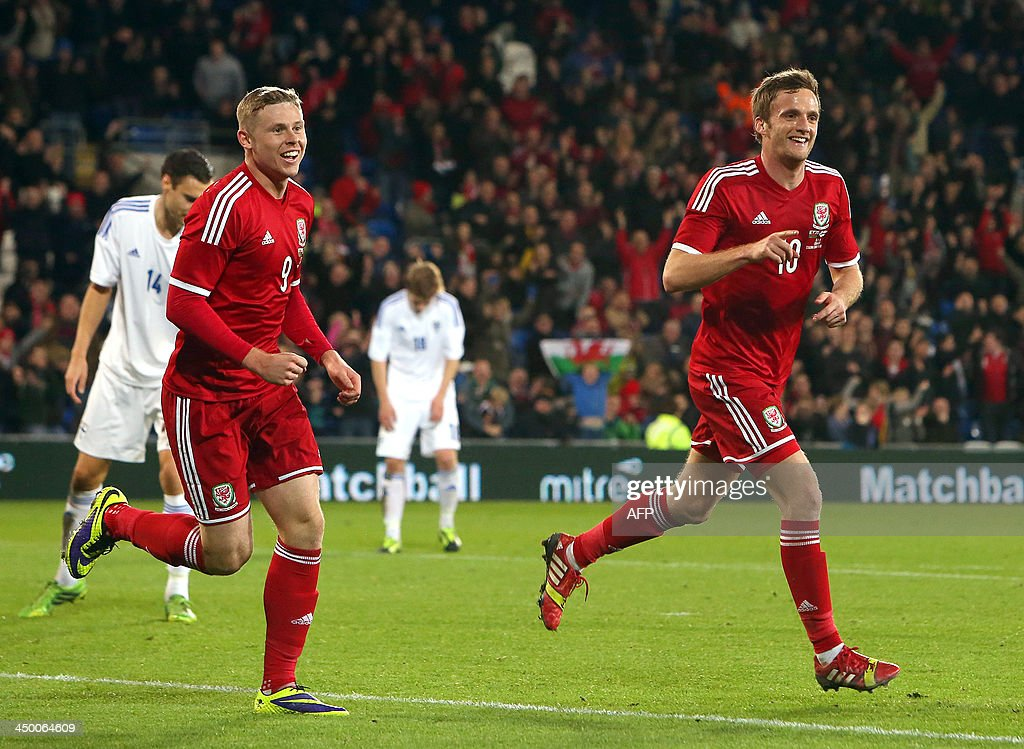Andy King (R) of Wales celebrates scoring the opening goal with teammate Simon Church (L) during the international friendly football match between Wales and Finland at Cardiff City Stadium in Cardiff, south Wales on November 16, 2013. The match ended 1-1.