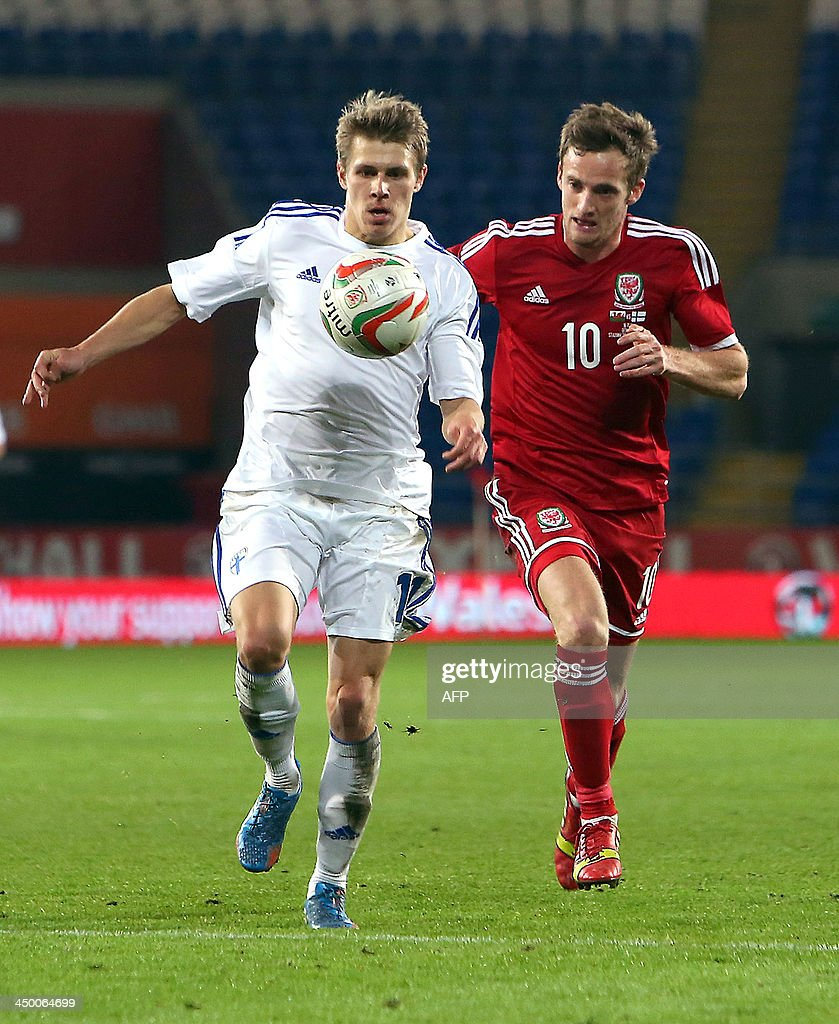 Andy King (R) of Wales challenges Riku RIski (L) of Finland during the international friendly football match between Wales and Finland at Cardiff City Stadium in Cardiff, south Wales on November 16, 2013. The match ended 1-1. AFP PHOTO / GEOFF CADDICK