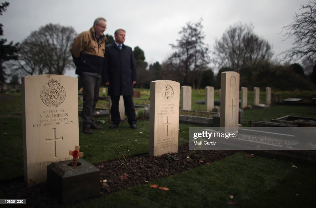 Andy Knowlson (L) from the Commonwealth War Graves Commission and John Rees (R) memorials officer for Wiltshire council look at a plot of war graves that have recently been restored inTrowbridge Cemetery on December 14, 2012 in Trowbridge, England. The group of 19 war graves has been renovated as part of a wider programme across the UK recognising those who died in the two world wars. The Commonwealth War Graves Commission is responsible for marking and maintaining the graves of those members of the Commonwealth forces who died during the two world wars, for building and maintaining memorials to the dead whose graves are unknown and for providing records and registers of these 1.7 million burials and commemorations found in most countries throughout the world.