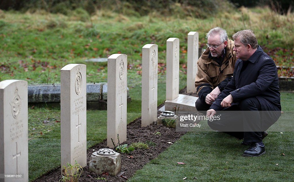 Andy Knowlson (L) from the Commonwealth War Graves Commission and John Rees (R) memorials officer for Wiltshire council look at a plot of war graves in Trowbridge Cemetery that have recently been restored on December 14, 2012 in Trowbridge, England. The group of 19 war graves has been renovated as part of a wider programme across the UK recognising those who died in the two world wars. The Commonwealth War Graves Commission is responsible for marking and maintaining the graves of those members of the Commonwealth forces who died during the two world wars, for building and maintaining memorials to the dead whose graves are unknown and for providing records and registers of these 1.7 million burials and commemorations found in most countries throughout the world.