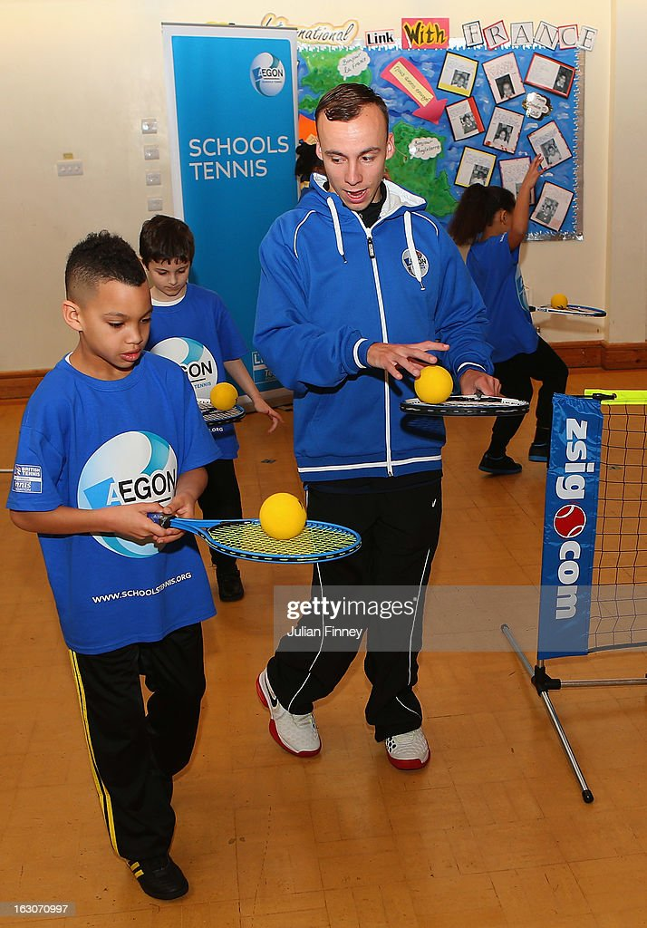 Andy Lapthorne helps school children play tennis at Britannia Village Primary School on March 4, 2013 in London, England. Aegon Schools Tennis Programme names Britannia Village Primary School, Newham as the 15,000th School beneficiary today which coincides with World Tennis Day.