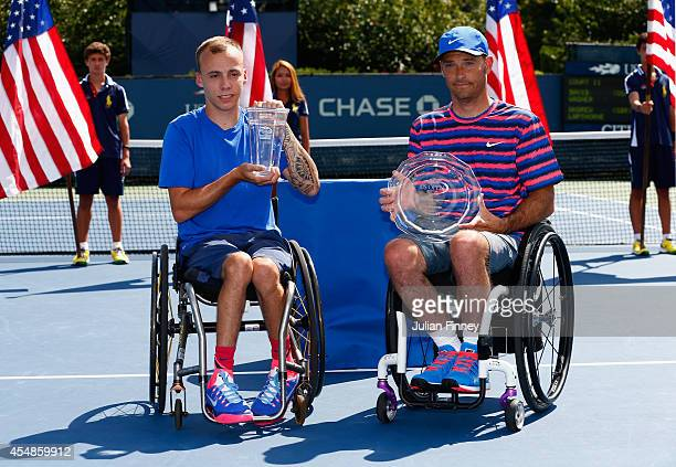 Andy Lapthorne of Great Britain and David Wagner of the United States pose following the men's wheelchair quad singles final on Day fourteen of the...