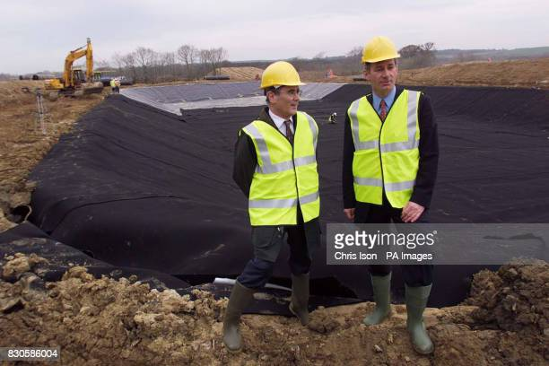 Andy Lebrecht Director of Operations for the Ministry of Agriculture in Devon and Defence Minister Geoff Hoon at the Ash Moor Barrows Devon site...