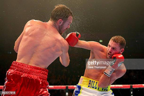 Andy Lee and Billy Joe Saunders fight during their WBO World Middleweight title bout at the Manchester Arena on December 19 2015 in Manchester England