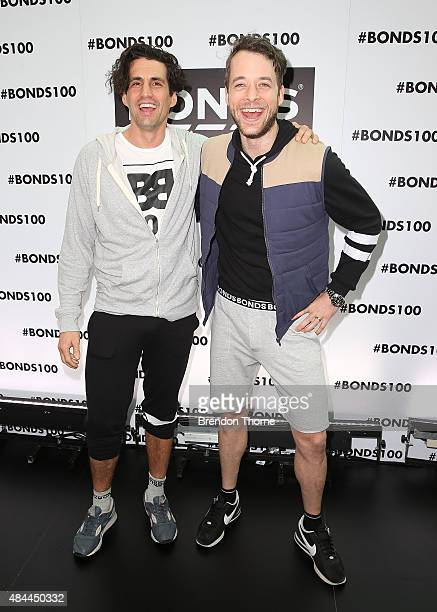 Andy Lee and Hamish Blake pose during Bonds 100th birthday celebration event at Cafe Sydney on August 19 2015 in Sydney Australia
