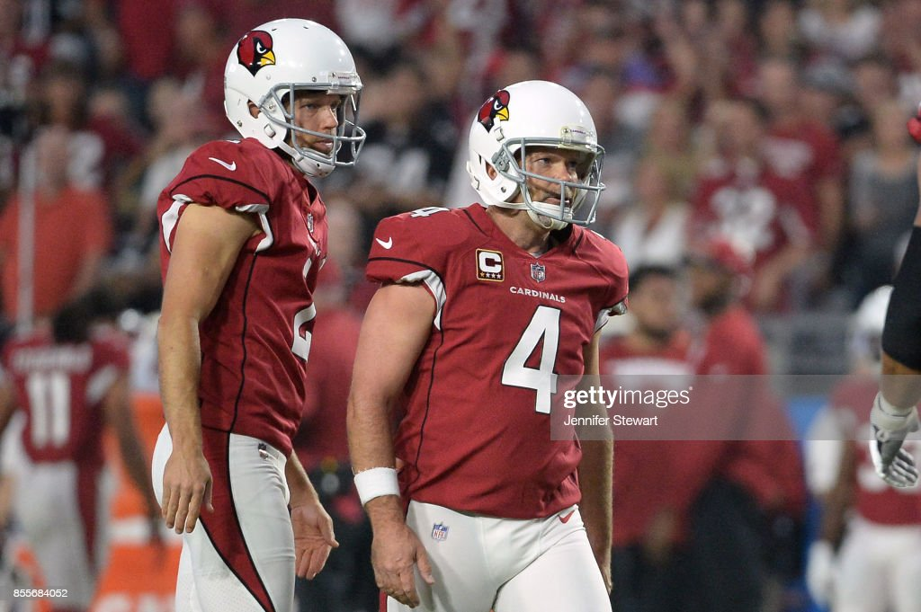 Andy Lee #2 and Phil Dawson #4 of the Arizona Cardinals react after missing a field goal in the first half of the NFL game against the Dallas Cowboys at University of Phoenix Stadium on September 25, 2017 in Glendale, Arizona.