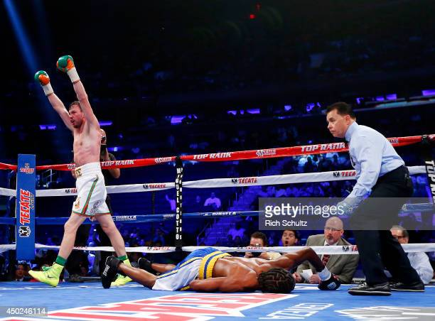 Andy Lee of Ireland raises his arms after knocking out John Jackson of theVirgin Islands in the fifth round of their NABF Super Welterweight title...
