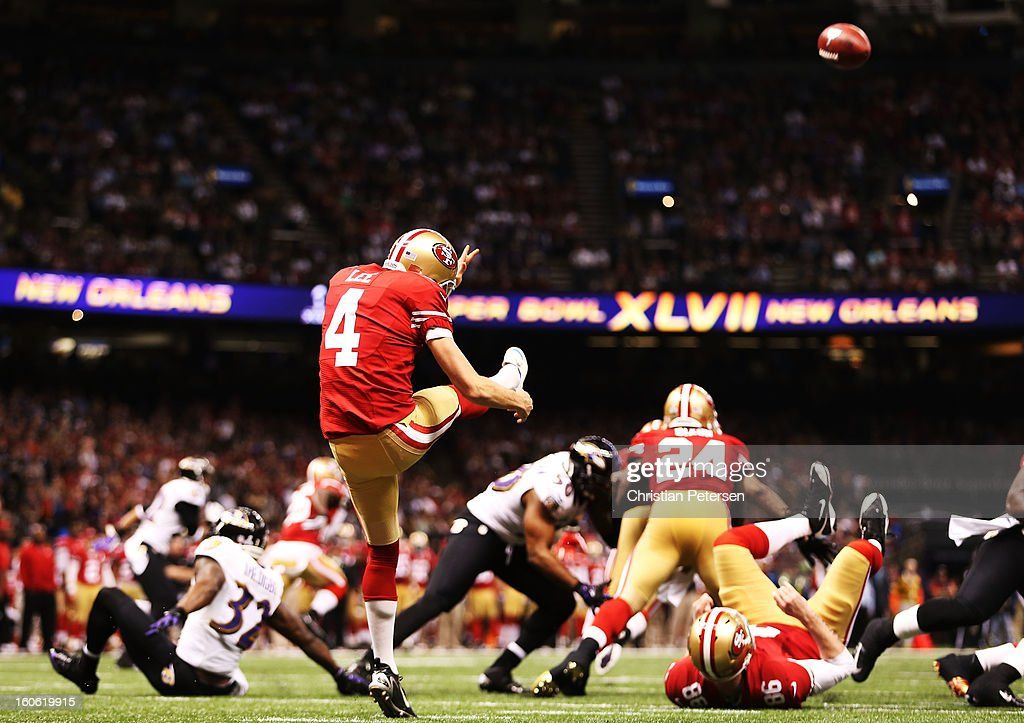 Andy Lee #4 of the San Francisco 49ers punts the ball against the Baltimore Ravens during Super Bowl XLVII at the Mercedes-Benz Superdome on February 3, 2013 in New Orleans, Louisiana.