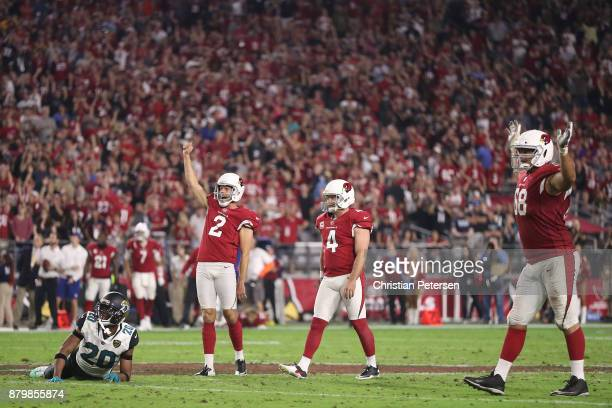 Andy Lee Phil Dawson and Jared Veldheer of the Arizona Cardinals celebrate after Dawson scores a 57 yard game winning field goal against the...