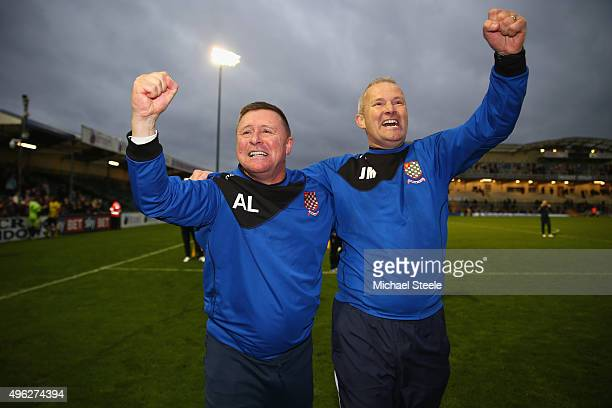 Andy Leese the manager of Chesham United celebrates his sides 10 victory at the final whistle alongside assistant manager Jon Meakes during the...