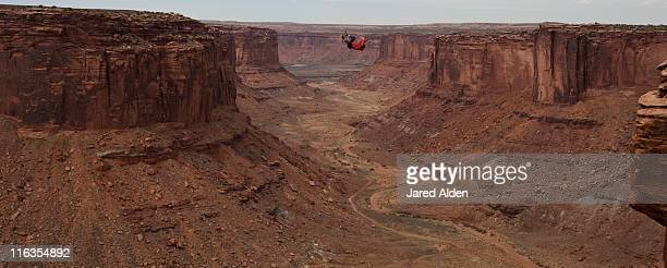 Andy Lewis tapes a world record highline, three hundred and forty feet long, at the Fruit Bowl in Moab, Utah, USA.