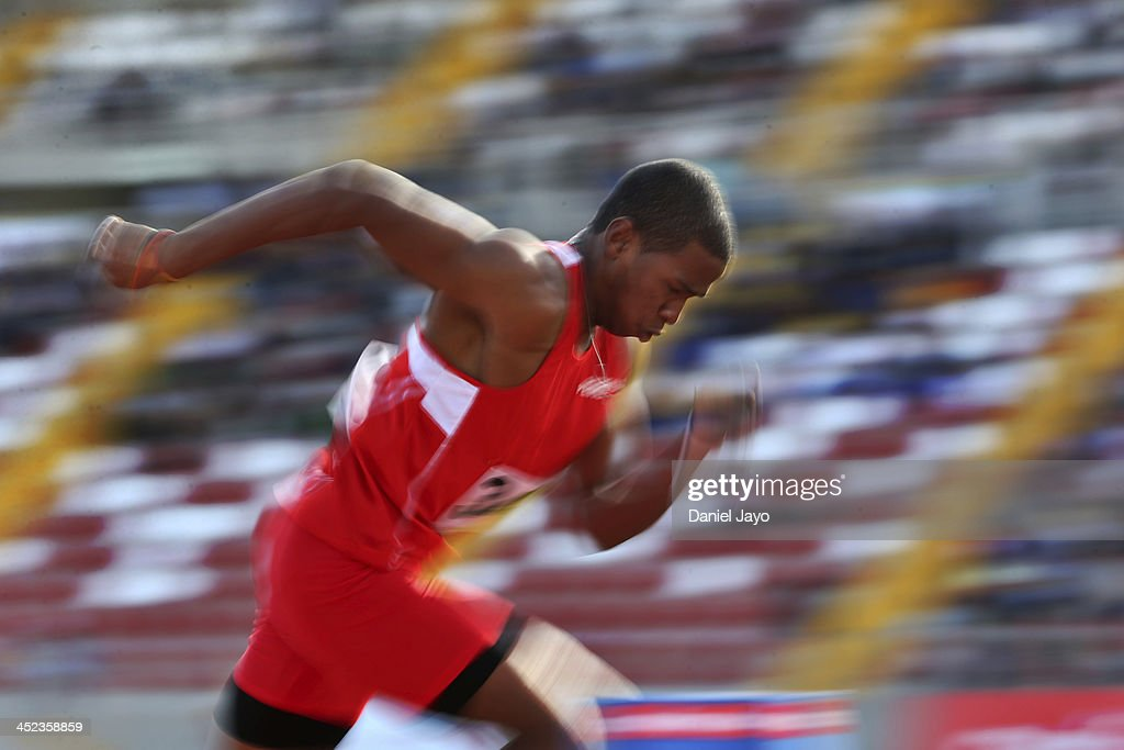 Andy Martinez of Peru competes in men's 200m final as part of the XVII Bolivarian Games Trujillo 2013 at Chan Chan Stadium on November 27, 2013 in Trujillo, Peru.