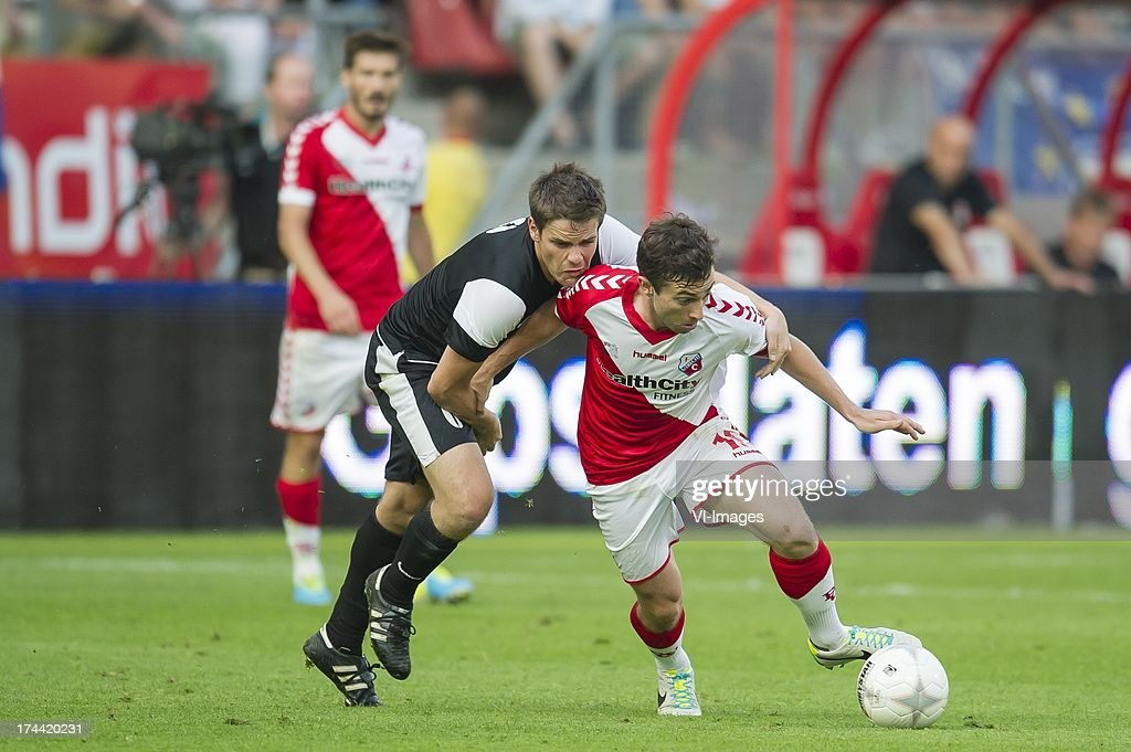 Andy May of FC Differdange 03, Tommy Oar of FC Utrecht during the Europa League second qualifying round match between FC Utrecht and FC Differdange on July 25, 2013 in Utrecht, The Netherlands.