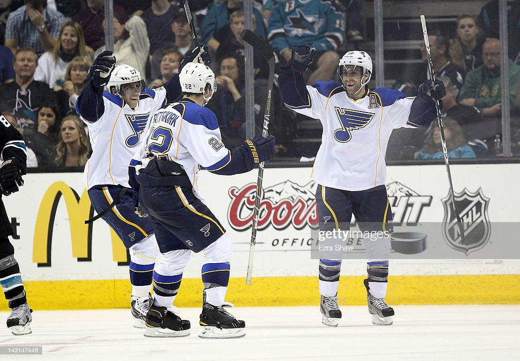 Andy McDonald is congratulated by Kevin Shattenkirk and David Perron of the St Louis Blues after McDonald scored a goal against the San Jose Sharks...